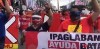 马尼拉工人们上街抗议,要求向穷人提供援助!