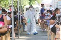 菲律宾累计新冠病例本周末将突破百万例